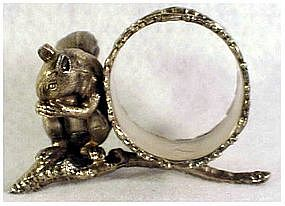 Victorian squirrel sitting on branch napkin ring eating