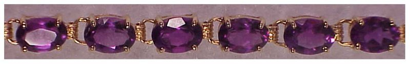 14K yg oval amethyst bracelet-10cts total stone weight