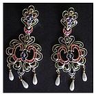 Trifari gold & metallic enamel scrolled crest earrings