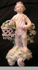 Derby Porcelain Figure of Putto with Pink Flowers
