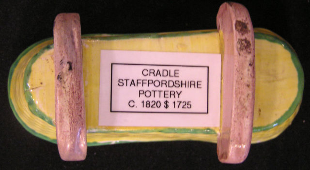 Staffordshire Pottery of Cradle w/Baby and Quilt