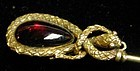 Stickpin of 15K gold snake with garnet