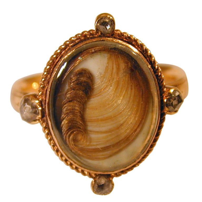"Ring, Memorial for ""John Hulman"" set with a hair curl"