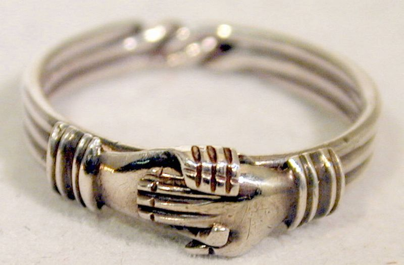 Ring, puzzle in silver of hands over a heart, c. 1850