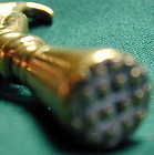 Pipe tamp, brass in the form of a hand