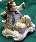 Porcelain ink and quill holder, youth holding grapes