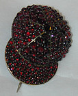 Brooch or pin of pave garnets in form of jockey cap