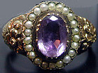 Ring, amethyst surrounded by pearls set in 18K