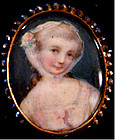Brooch of a miniature portrait of a young woman painted