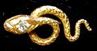 Stickpin of 14K yellow gold snake with diamond in head