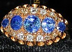 Ring of 5 sapphires and 14 diamonds in 18K gold