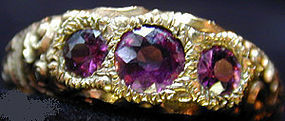 Ring of 3 stone amethyst set in chased 14K