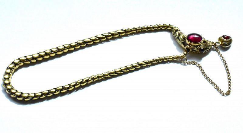 18 Karat Snake Bracelet with Garnet Head, circa 1860