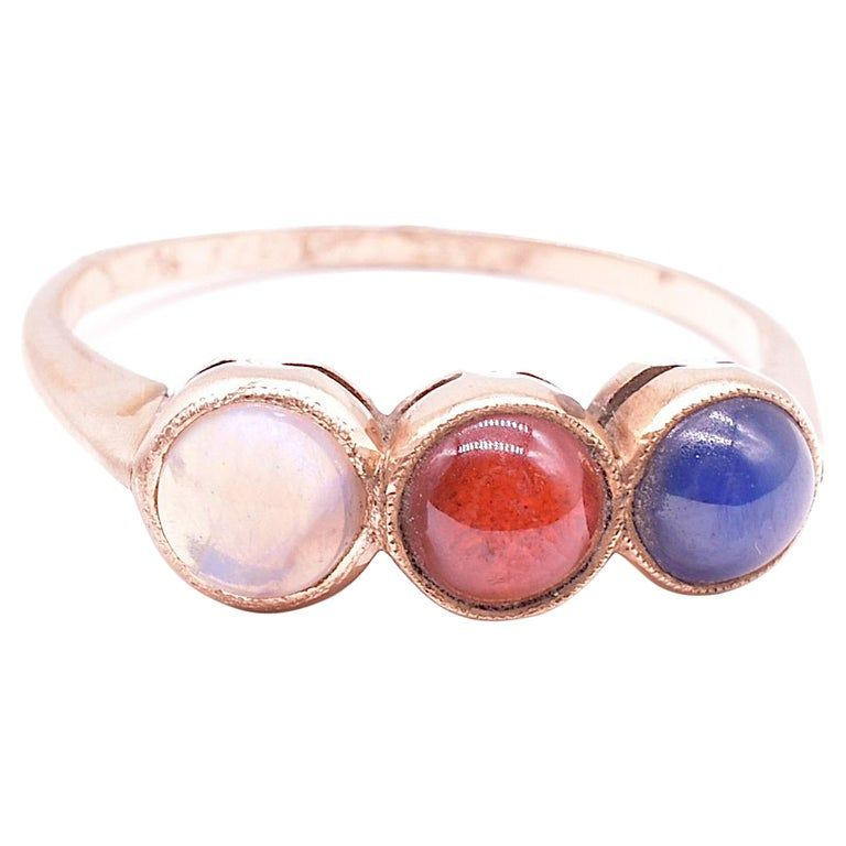 Victorian Trilogy Ring of Opal, Garnet, and Sapphire