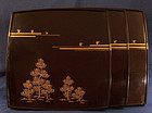 Three matching Japanese lacquer trays and a fourth tray