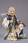 Japanese Kyo-Satsuma enamel decorated stoneware figure