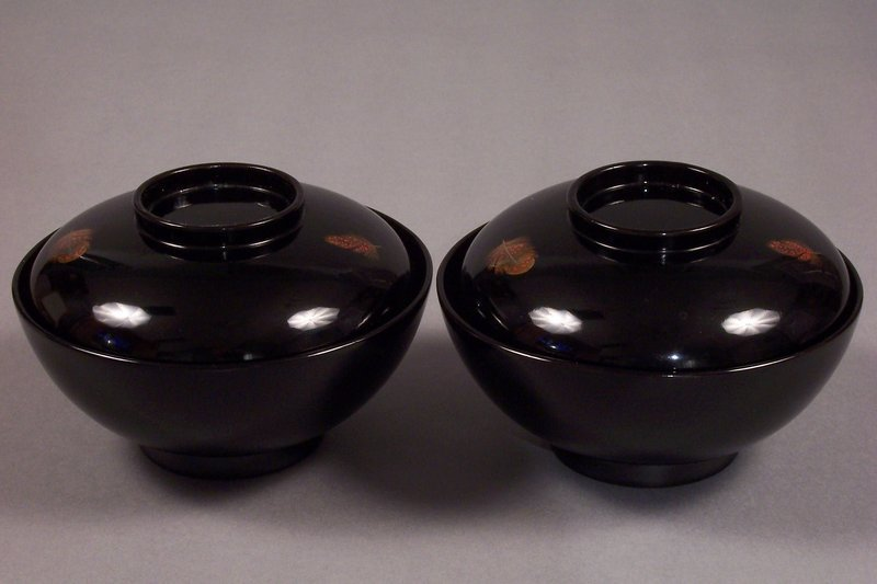 Two Zohiko lacquer covered bowls. 5 inch, feather motif