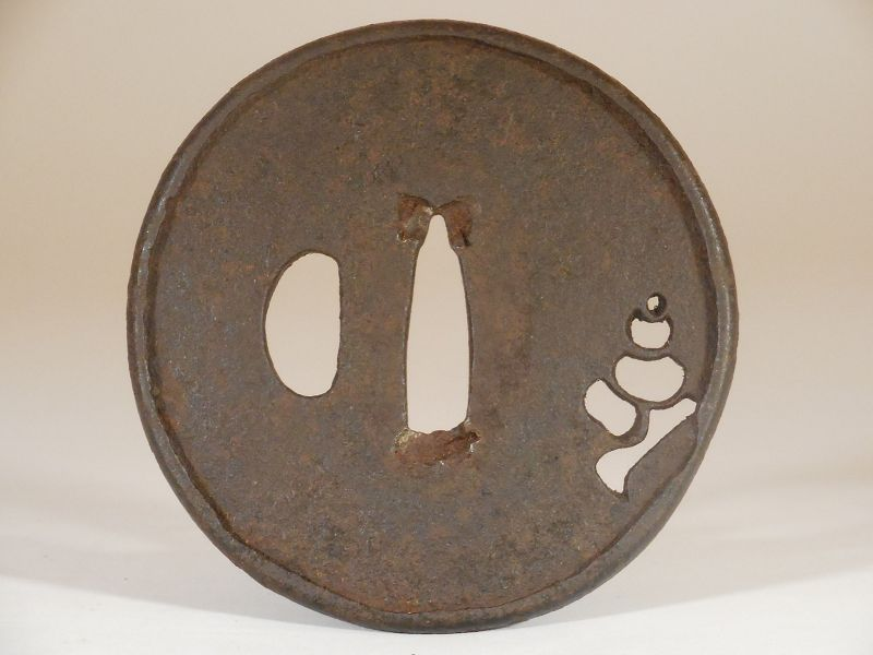 Small Ko-katchushi Iron Tsuba with Sukashi Decoration of a Conch Shell