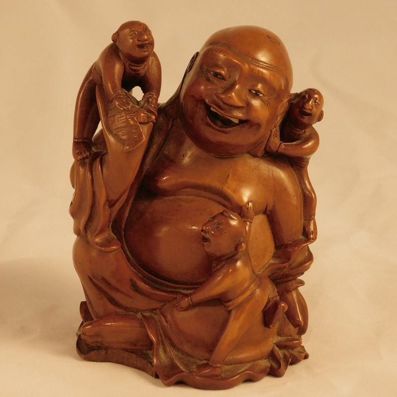 A Good Chinese Boxwood Carving of Budai, with Bat and Children