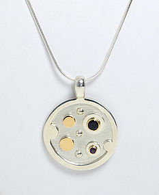 Silver Pendant with 18 Karat Gold and Stones