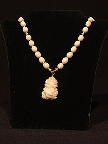 Angelskin Coral Carved Pendant and Bead Necklace