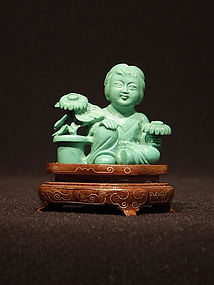 Small Turquoise Carving of a Girl Seated with Flowers