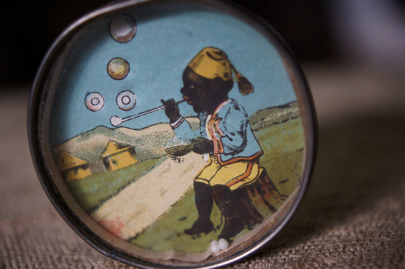 C1920s Dexterity Game Black Boy in Fez Blowing Bubbles