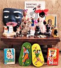 Group of 27 Black Americana Dolls Mask Jewelry Ceramics Book Toys