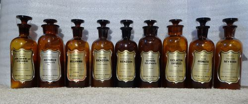 Nine C1920s J. Wyeth Apothecary Bottles w/ fancy Shield Labels