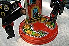 Late 1950's Metal Black Golliwog Windup Merry-Go-Round