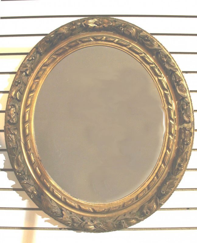Antique Carved And Gilt Wood Oval Mirror