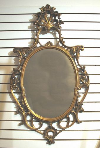 Antique Continental Carved and Gilt Wood Oval Mirror