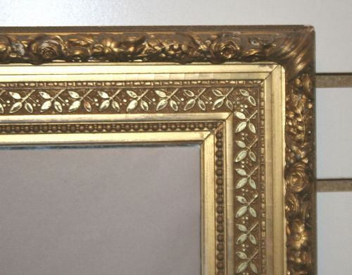 Antique Foliate Carved Gilt Wood and Gesso Mirror