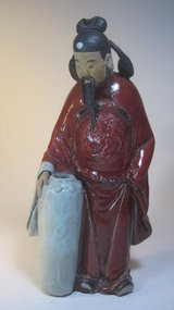 Early 20th C. Chinese Shiwan Red Glazed Mudman MK