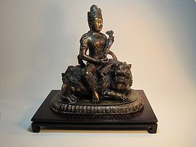 A 19th C. Chinese Bronze Quanyin Sitting On A Foo Lion