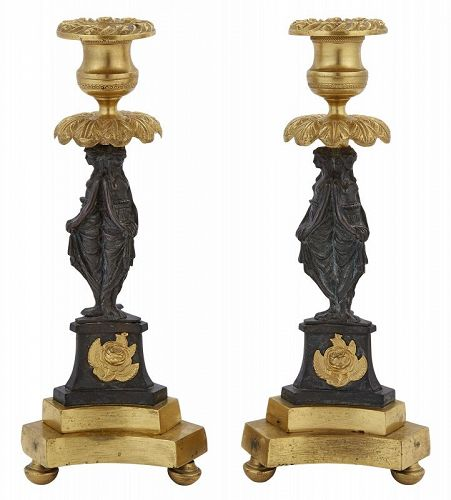 Pair of French bronze and parcel gilt candlesticks  19th c