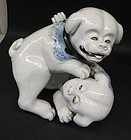 Japanese porcelain two puppies sculpture