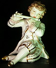 German  porcelain figurine of a boy playing flute