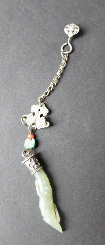 Carved jade and silver lucky charm
