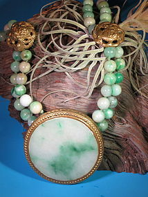 Jadeite necklace with silver fu-lion embellishment