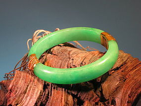 Jade bangle with 14 K gold fitting