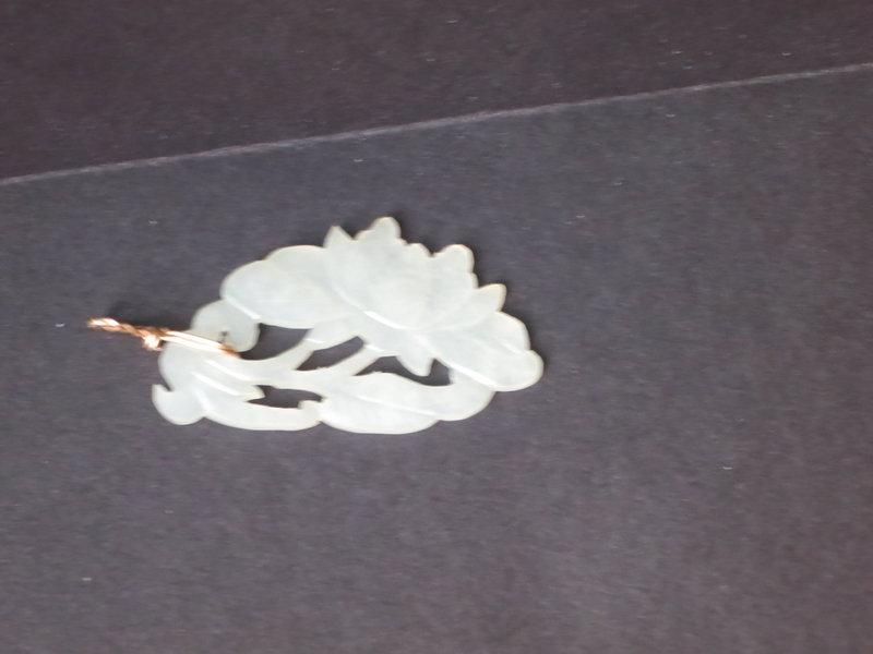 white jade carved pendant