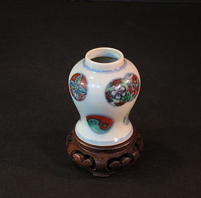 Miniture antique Chinese porcelain jar with carved base