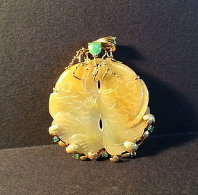 Carved double jade  fish with gold and emerald setting