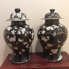 A pair of Famille noire enameled porcelain cover jars