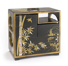 A gilt and black lacquer picnic box