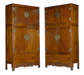 A pair of massive mix wood compound cupboards