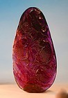 Finely carved ruby red tourmaline fish and lotus pendant