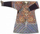 An embroidered russet silk ground dragon robe