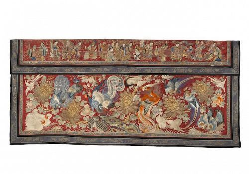 An embroidered red silk wall hanging